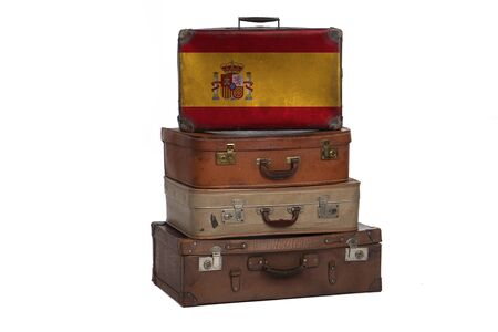 Spain, Spanish travel concept. Group of vintage suitcases isolated on white background