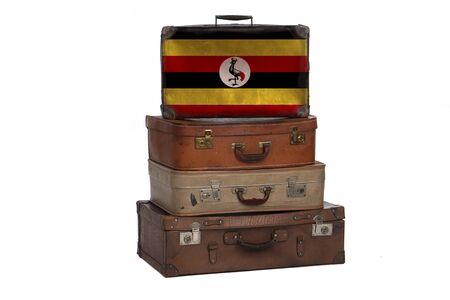 Uganda, Ugandan travel concept. Group of vintage suitcases isolated on white background