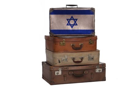 Israel, Israeli travel concept. Group of vintage suitcases isolated on white background