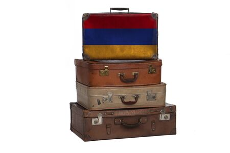 Armenia, Armenian travel concept. Group of vintage suitcases isolated on white background
