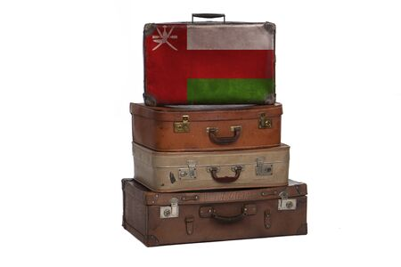 Oman, Omani travel concept. Group of vintage suitcases isolated on white background