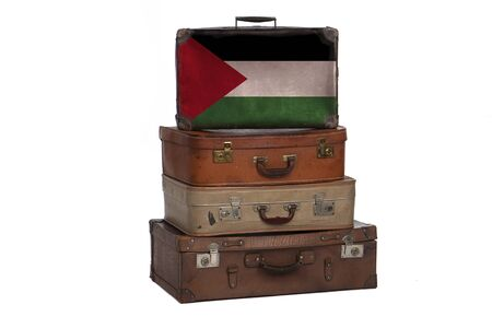Palestine, Palestinian travel concept. Group of vintage suitcases isolated on white background