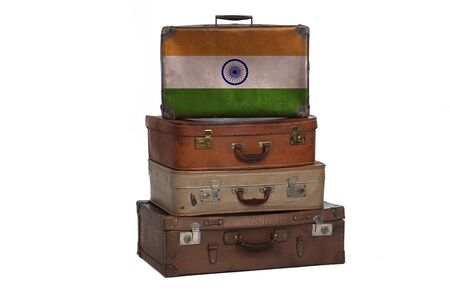 India, Indian travel concept. Group of vintage suitcases isolated on white background