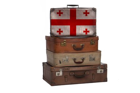 Georgia, Georgian travel concept. Group of vintage suitcases isolated on white background