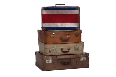 Costa Rica travel concept. Group of vintage suitcases isolated on white background