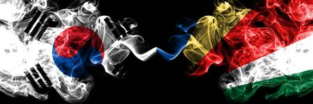 South Korea vs Seychelles, Seychelloise smoky mystic flags placed side by side. Thick colored silky abstract smoke flags of South Korean and Seychelles, Seychelloise