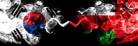 South Korea vs Oman, Omani smoky mystic flags placed side by side. Thick colored silky abstract smoke flags of South Korean and Oman, Omani