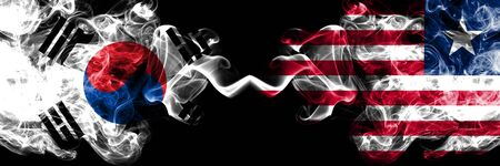 South Korea vs Liberia, Liberian smoky mystic flags placed side by side. Thick colored silky abstract smoke flags of South Korean and Liberia, Liberian Stock Photo