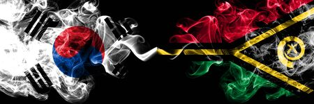 South Korea vs Vanuatu smoky mystic flags placed side by side. Thick colored silky abstract smoke flags of South Korean and Vanuatu Stock Photo