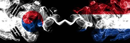 South Korea vs Netherlands, Dutch smoky mystic flags placed side by side. Thick colored silky abstract smoke flags of South Korean and Netherlands, Dutch Stock Photo