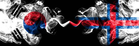 South Korea vs Faroe Islands smoky mystic flags placed side by side. Thick colored silky abstract smoke flags of South Korean and Faroe Islands