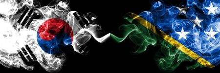 South Korea vs Solomon Islands smoky mystic flags placed side by side. Thick colored silky abstract smoke flags of South Korean and Solomon Islands