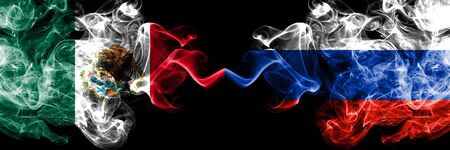Mexico vs Russia, Russian smoky mystic flags placed side by side. Thick colored silky abstract smokes banner of Mexican and Russia, Russian Stock Photo