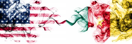 United States of America vs Cameroon, Cameroonian smoky mystic flags placed side by side. Thick colored silky abstract smokes banner of America and Cameroon, Cameroonian Foto de archivo