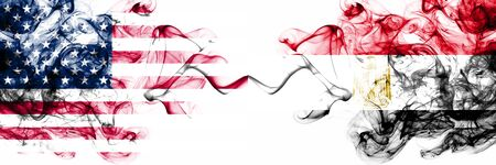 United States of America vs Egypt, Egyptian smoky mystic flags placed side by side. Thick colored silky abstract smokes banner of America and Egypt, Egyptian