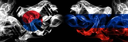 South Korea, Korean, Russia, Russian smoky mystical flags placed side by side. Thick colored silky smokes flag concept Фото со стока
