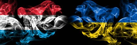 Luxembourg, Ukraine competition thick colorful smoky flags. European football qualifications games Stockfoto