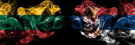 Lithuania, Serbia competition thick colorful smoky flags. European football qualifications games