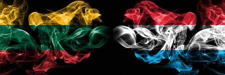 Lithuania, Luxembourg competition thick colorful smoky flags. European football qualifications games