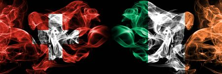 Switzerland, Republic of Ireland competition thick colorful smoky flags. European football qualifications games
