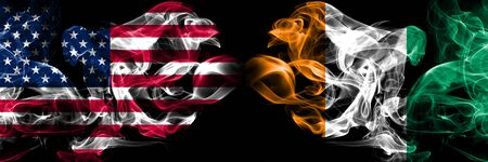 United States of America, USA vs Ivory Coast background abstract concept peace smokes flags.