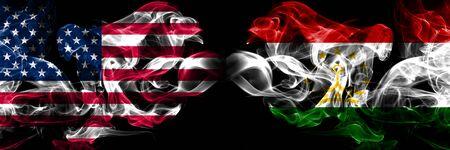 United States of America, USA vs Tajikistan, Tajikistani background abstract concept peace smokes flags. Stock Photo