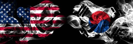 United States of America, USA vs South Korea, Korean background abstract concept peace smokes flags.