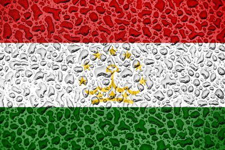 Tajikistan national flag made of water drops. Background forecast season concept. Фото со стока