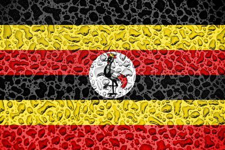 Uganda national flag made of water drops. Background forecast season concept.