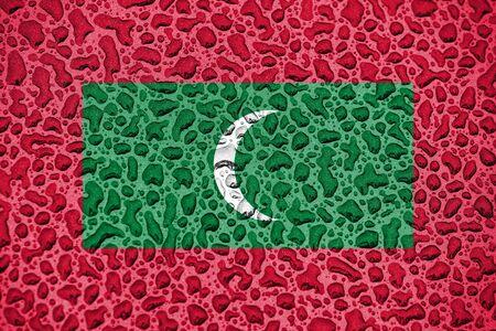 Maldives national flag made of water drops. Background forecast season concept. Фото со стока