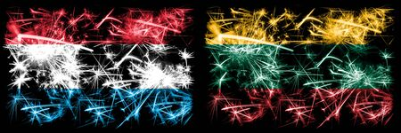 Luxembourg, Lithuania sparkling fireworks concept and idea flags Stockfoto