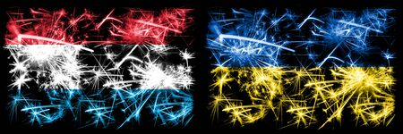Luxembourg, Ukraine sparkling fireworks concept and idea flags Stockfoto