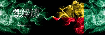 Saudi Arabia Kingdom vs Benin, Beninese smoky mystic flags placed side by side. Thick colored silky smoke flags of Arabic, Arabian and Benin, Beninese Banco de Imagens