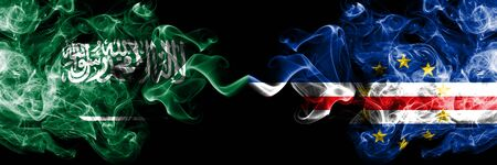 Saudi Arabia Kingdom vs Cape Verde smoky mystic flags placed side by side. Thick colored silky smoke flags of Arabic, Arabian and Cape Verde