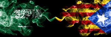 Saudi Arabia Kingdom vs Catalonia, Spain smoky mystic flags placed side by side. Thick colored silky smoke flags of Arabic, Arabian and Catalonia, Spain