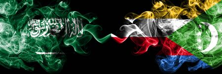 Saudi Arabia Kingdom vs Comoros, Comorian smoky mystic flags placed side by side. Thick colored silky smoke flags of Arabic, Arabian and Comoros, Comorian