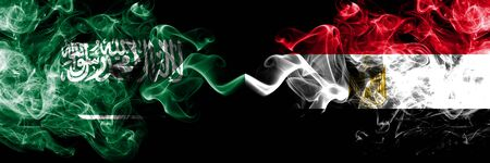 Saudi Arabia Kingdom vs Egypt, Egyptian smoky mystic flags placed side by side. Thick colored silky smoke flags of Arabic, Arabian and Egypt, Egyptian Banco de Imagens