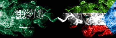 Saudi Arabia Kingdom vs Equatorial Guinea smoky mystic flags placed side by side. Thick colored silky smoke flags of Arabic, Arabian and Equatorial Guinea Banco de Imagens