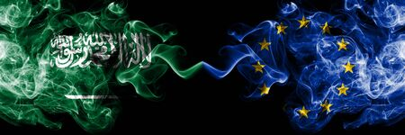 Saudi Arabia Kingdom vs European Union, EU smoky mystic flags placed side by side. Thick colored silky smoke flags of Arabic, Arabian and European Union, EU