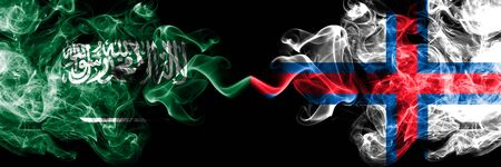 Saudi Arabia Kingdom vs Faroe Islands smoky mystic flags placed side by side. Thick colored silky smoke flags of Arabic, Arabian and Faroe Islands Banco de Imagens