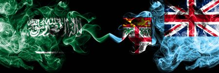 Saudi Arabia Kingdom vs Fiji smoky mystic flags placed side by side. Thick colored silky smoke flags of Arabic, Arabian and Fiji Banco de Imagens