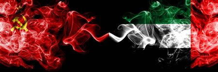 Communist vs United Arab Emirates, Emirati abstract smoky mystic flags placed side by side. Thick colored silky smoke flags of Communism and United Arab Emirates, Emirati Stockfoto
