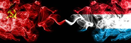 Communist vs Luxembourg abstract smoky mystic flags placed side by side. Thick colored silky smoke flags of Communism and Luxembourg Stockfoto