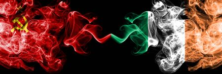 Communist vs Ireland, Irish abstract smoky mystic flags placed side by side. Thick colored silky smoke flags of Communism and Ireland, Irish