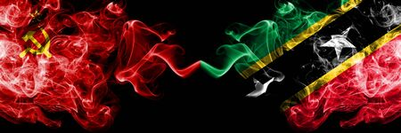 Communist vs Saint Kitts and Nevis abstract smoky mystic flags placed side by side. Thick colored silky smoke flags of Communism and Saint Kitts and Nevis