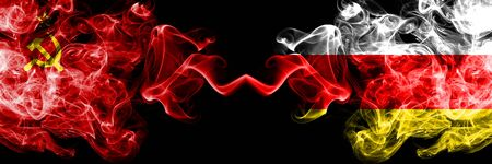 Communist vs South Ossetia abstract smoky mystic flags placed side by side. Thick colored silky smoke flags of Communism and South Ossetia