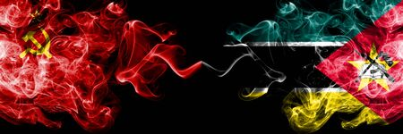 Communist vs Mozambique, Mozambican abstract smoky mystic flags placed side by side. Thick colored silky smoke flags of Communism and Mozambique, Mozambican Standard-Bild
