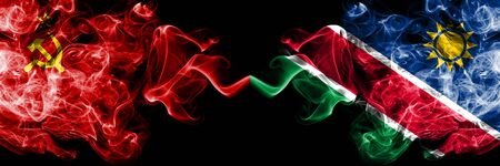 Communist vs Namibia, Namibian abstract smoky mystic flags placed side by side. Thick colored silky smoke flags of Communism and Namibia, Namibian