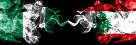 Nigeria vs Lebanon, Lebanese abstract smoky mystic flags placed side by side. Thick colored silky smoke flags of Nigerian and Lebanon, Lebanese Banco de Imagens - 130621808