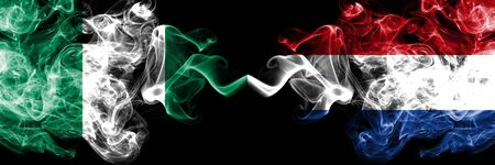 Nigeria vs Netherlands, Dutch abstract smoky mystic flags placed side by side. Thick colored silky smoke flags of Nigerian and Netherlands, Dutch Banco de Imagens - 130621801